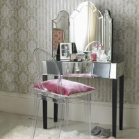Ghost chair with mirrored vanity and wallpaper