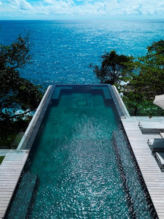infinity pool overlooking ocean - photo #23